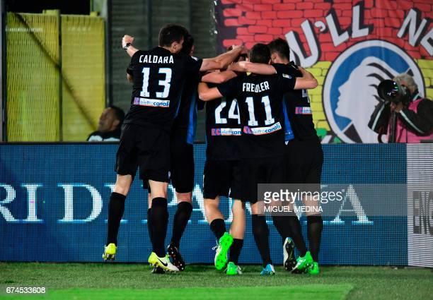Atalanta players congratulate teammate defender Andrea Conti after scoring during the Italian Serie A football match Atalanta vs Juventus at the...
