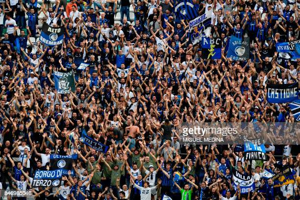Atalanta supporters shout and wave scarves ahead of the start of the UEFA Europa League Group E football match Atalanta vs Everton at The Stadio...