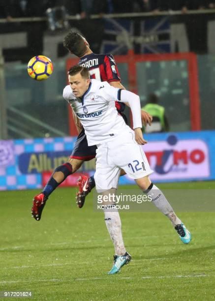 STADIUM CROTONE CALABRIA ITALY Atalanta'a Danish forward Andreas Cornelius heads the ball as fighting with Crotone's Italian defender Davide Faraoni...