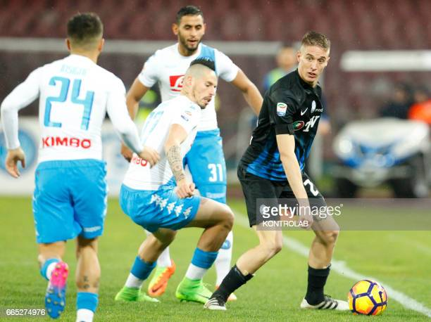 Atalanta'a Italian defender Andrea Conti vies with Napoli's Slovakian midfielder Marek Hamsik during the Italian Serie A football match SSC Napoli vs...