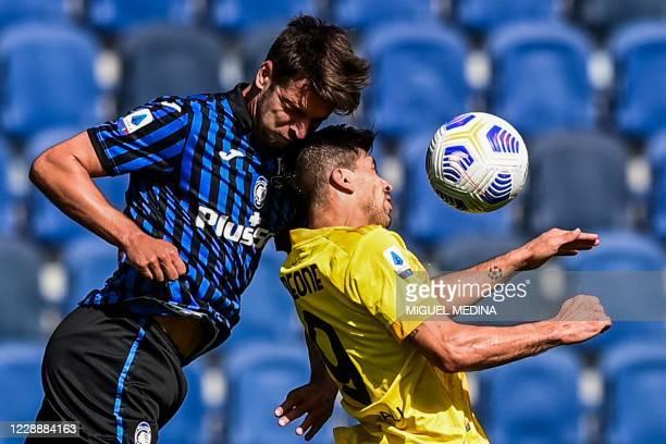 Atalanta's Albanian defender Berat Djimsiti and Cagliari's Argentine forward Giovanni Simeone go for a header during the Italian Serie A football...