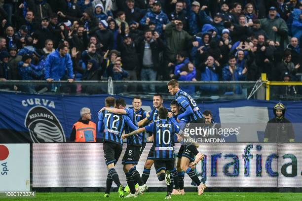 Atalanta's Albanian defender Berat Djimsiti celebrates with teammates after he scored a header during the Italian Serie A football match Atalanta...