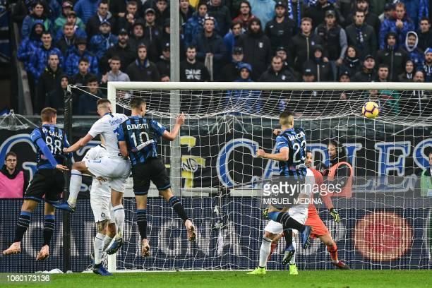 Atalanta's Albanian defender Berat Djimsiti scores a header during the Italian Serie A football match Atalanta Bergamo v Inter Milan at the Atleti...