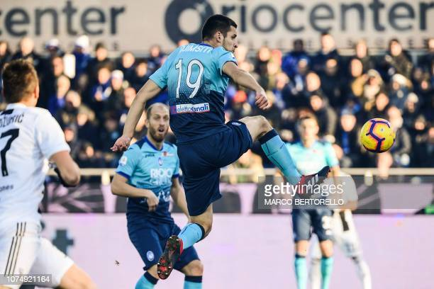 Atalanta's Albanian defender Berat Djimsiti scores an own goal during the Italian Serie A football Match Atalanta Bergamo vs Juventus on December 26,...