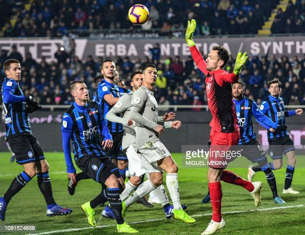 Atalanta's Albanian goalkeeper Etrit Berisha defends against Juventus' Portuguese forward Cristiano Ronaldo during the Italian Tim Cup round of eight...