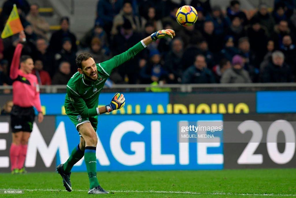 Atalanta's Albanian goalkeeper Etrit Berisha throws the ball ...