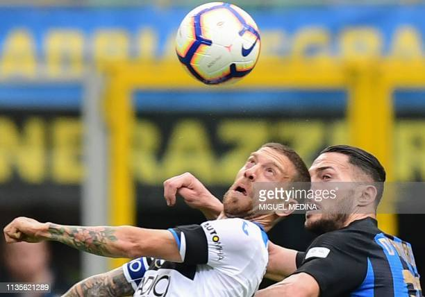 Atalanta's Argentine forward Alejandro Gomez and Inter Milan's Italian defender Danilo D'Ambrosio go for a header during the Italian Serie A football...