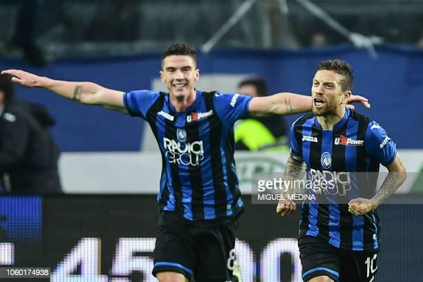 Atalanta's Argentine forward Alejandro Gomez celebrates with Atalanta's German defender Robin Gosens after scoring during the Italian Serie A...