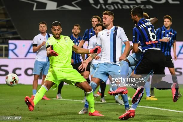 Atalanta's Argentinian defender Jose Luis Palomino scores a header past Lazio's Albanian goalkeeper Thomas Strakosha during the Italian Serie A...