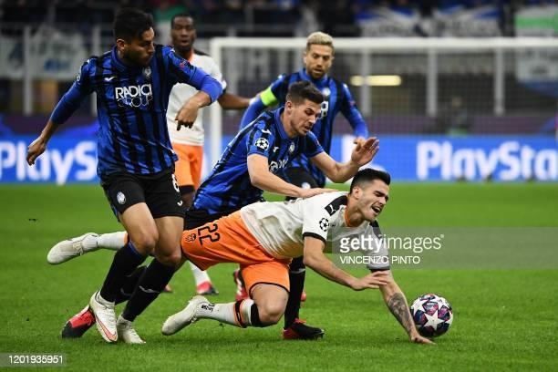 Atalanta's Argentinian defender Jose Luis Palomino tackles Valencia's Uruguayan forward Maxi Gomez during the UEFA Champions League round of 16 first...