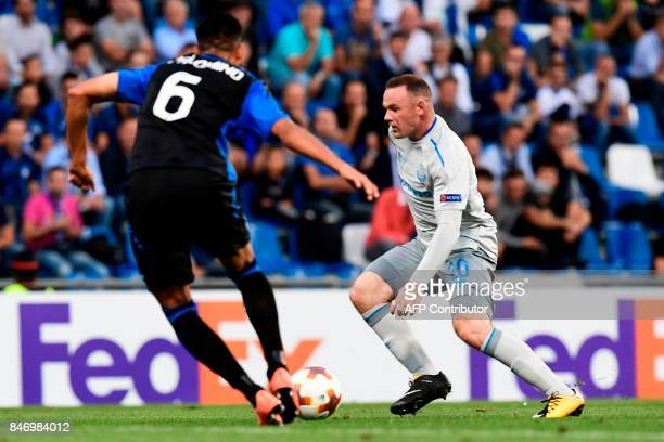 Atalanta's Argentinian defender Jose Luis Palomino vies with Everton's British forward Wayne Rooney during the UEFA Europa League Group E football...