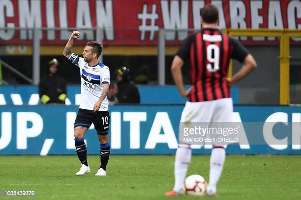 Atalanta's Argentinian forward Alejandro Gomez celebrates after scoring a goal during the Italian Serie A football match between AC Milan and...