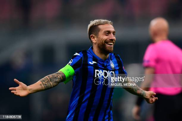 Atalanta's Argentinian forward Papu Gomez celebrates after scoring his team's second goal during the UEFA Champions League Group C football match...