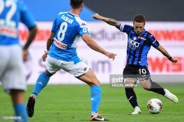 Atalanta's Argentinian forward Papu Gomez shoots on goal during the Italian Serie A football match Atalanta vs Napoli played on July 2 2020 behind...