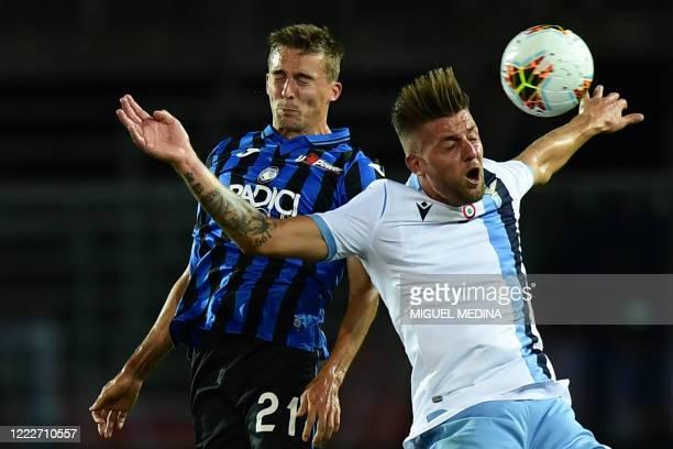 Atalanta's Belgian defender Timothy Castagne and Lazio's Serbian midfielder Sergej Milinkovic-Savic go for a header during the Italian Serie A...