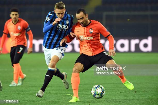 Atalanta's Belgian defender Timothy Castagne and Shakhtar Donetsk's Brazilian defender Ismaily vie for the ball during the UEFA Champions League...