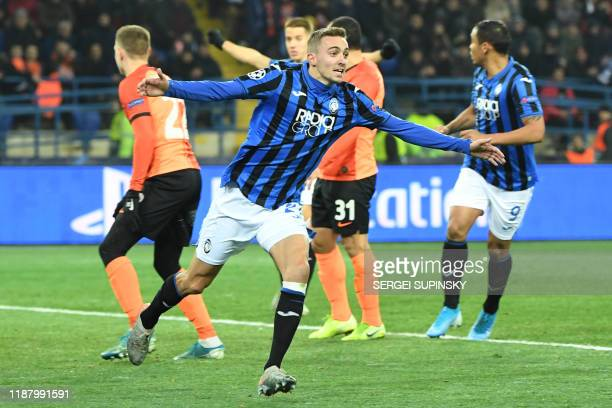 TOPSHOT Atalanta's Belgian defender Timothy Castagne celebrates a goal awarded after a VAR review during the UEFA Champions League group C football...