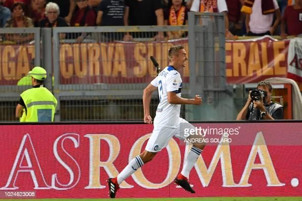 Atalanta's Belgian defender Timothy Castagne celebrates after scoring during the Italian Serie A football match Roma vs Atalanta at Rome's Olympic...
