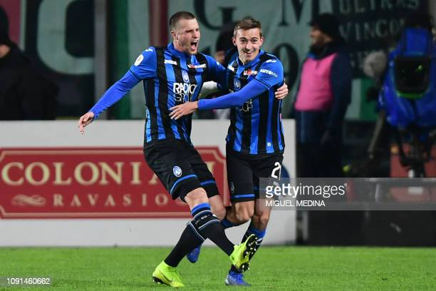 Atalanta's Belgian defender Timothy Castagne celebrates with Atalanta's Dutch defender Hans Hateboer after opening the scoring during the Italian Tim...