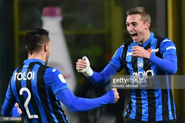 Atalanta's Belgian defender Timothy Castagne celebrates with Atalanta's Brazilian defender Rafael Toloi after opening the scoring during the Italian...