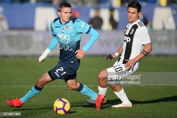Atalanta's Belgian defender Timothy Castagne holds off Juventus' Argentine forward Paulo Dybala during the Italian Serie A football Match Atalanta...