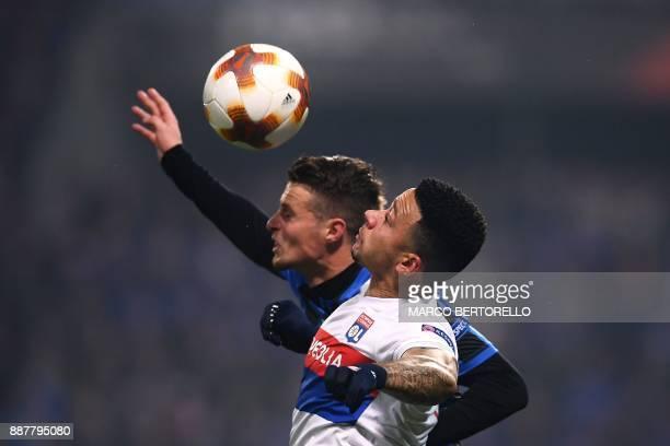 Atalanta's Brazilian defender Rafael Toloi vies with Lyon's Dutch forward Memphis Depay during the UEFA Europa League group E football match Atalanta...