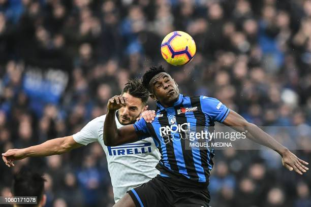 Atalanta's Colombian forward Duvan Zapata and Inter Milan's Italian defender Danilo D'Ambrosio go for a header during the Italian Serie A football...