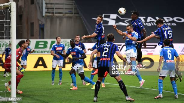 Atalanta's Colombian forward Duvan Zapata and Napoli's Serbian defender Nikola Maksimovic '4thR) go for a header during the Italian Serie A football...