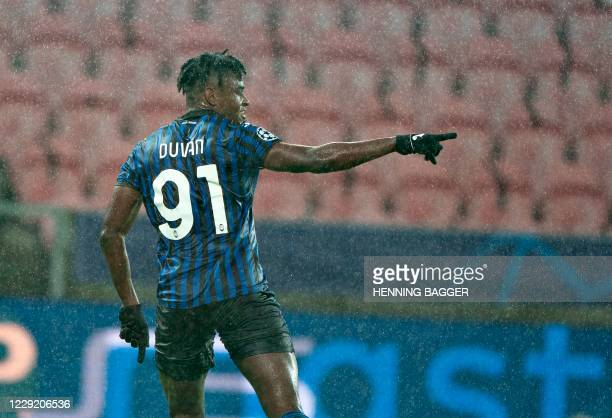 Atalanta's Colombian forward Duvan Zapata celebrates scoring the opening goal during the UEFA Champions League group D football match FC Midtjylland...