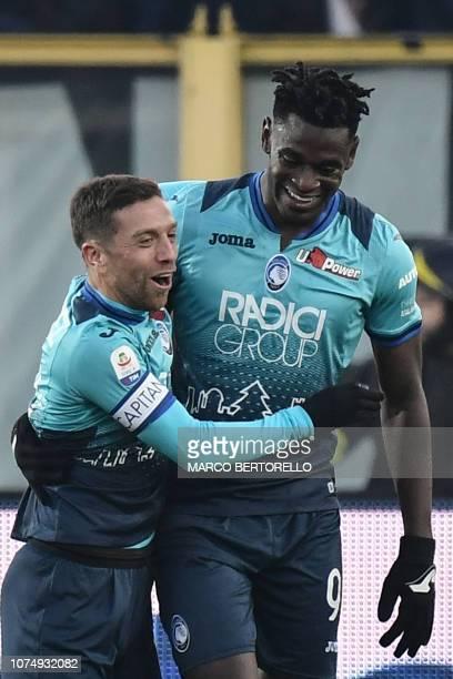 Atalanta's Colombian forward Duvan Zapata celebrates with Atalanta's Argentine forward Alejandro Gomez after scoring 2-1 during the Italian Serie A...