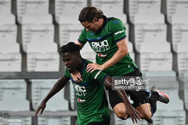 Atalanta's Colombian forward Duvan Zapata celebrates with Atalanta's Dutch defender Hans Hateboer after opening the scoring during the Italian Serie...