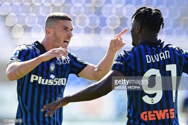 Atalanta's Colombian forward Duvan Zapata celebrates with Atalanta's German defender Robin Gosens after scoring during the Italian Serie A football...