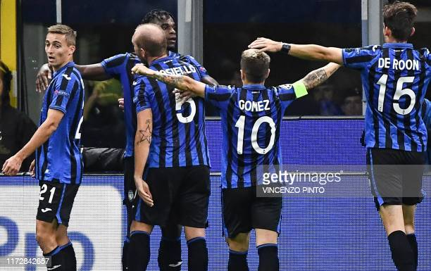 Atalanta's Colombian forward Duvan Zapata celebrates with teammates after opening the scoring during the UEFA Champions League Group C stage football...