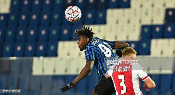 Atalanta's Colombian forward Duvan Zapata fights for the ball with Ajax's Dutch defender Perr Schuurs during the UEFA Champions League group D...