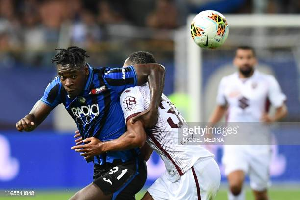 Atalanta's Colombian forward Duvan Zapata vies with Torino's Ivorian defender Koffi Djidji during the Italian Serie A football match Atalanta vs...
