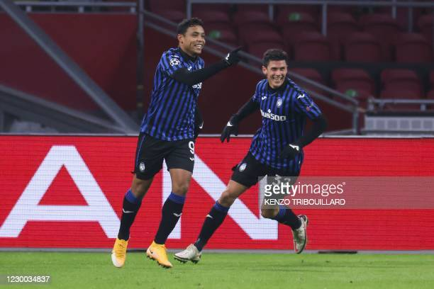 Atalanta's Colombian forward Luis Muriel celebrates after scoring a goal during the UEFA Champions League Group D football match between Ajax...