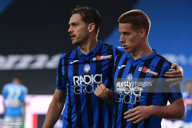 Atalanta's Croatian midfielder Mario Pasalic celebrates with Atalanta's Brazilian defender Rafael Toloi after opening the scoring during the Italian...