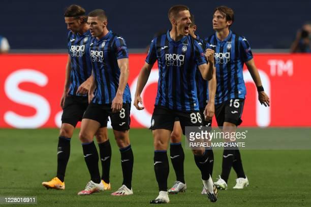 Atalanta's Croatian midfielder Mario Pasalic celebrates with teammates after scoring a goal during the UEFA Champions League quarterfinal football...