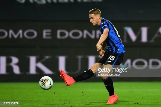 Atalanta's Croatian midfielder Mario Pasalic kicks to score his team fifth goal during the Italian Serie A football match Atalanta vs Brescia played...