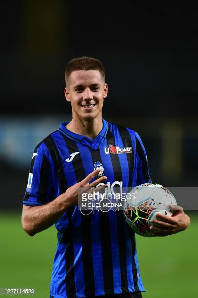 Atalanta's Croatian midfielder Mario Pasalic poses at the end of the match after scoring three goals during the Italian Serie A football match...