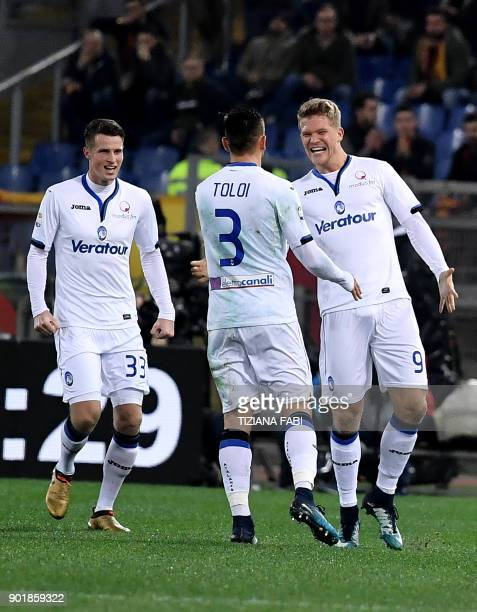 Atalanta's Danish forward Andreas Cornelius celebrates after scoring a goal during the Serie A football match between Roma and Atalanta at Olimpic...