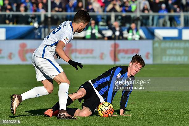 Atalanta's defender from Italy Andrea Conti fights for the ball with Inter Milan's defender from Brazil Alex Telles during the Italian Seria A...