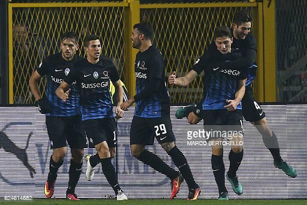 Atalanta's defender Mattia Caldara celebrates with his teammates after scoring during the Italian Serie A football match Atalanta vs As Roma on...