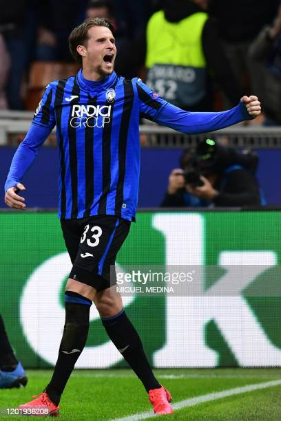 Atalanta's Dutch defender Hans Hateboer celebrates after opening the scoring during the UEFA Champions League round of 16 first leg football match...
