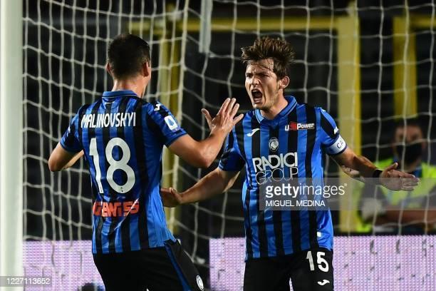 Atalanta's Dutch midfielder Marten de Roon celebrates with Atalanta's Ukrainian midfielder Ruslan Malinovskyi after scoring his team's second goal...