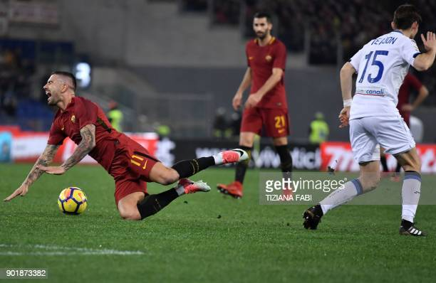 Atalanta's Dutch midfielder Marten de Roon fights for the ball with Fiorentina's Roma's defender from Serbia Aleksandar Kolarov during the Serie A...