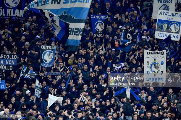Atalanta's fans cheer prior to the UEFA Champions League round of 16 first leg football match Atalanta Bergamo vs Valencia on February 19 2020 at the...