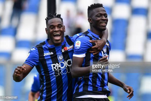Atalanta's Gambian forward Musa Barrow celebrates with Atalanta's Colombian forward Duvan Zapata after opening the scoring during the Italian Serie A...