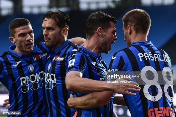 Atalanta's German defender Robin Gosens Atalanta's Brazilian defender Rafael Toloi Atalanta's Swiss midfielder Remo Freuler and Atalanta's Croatian...