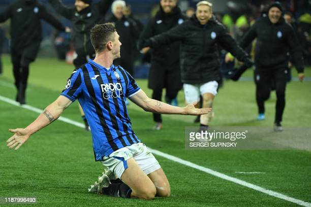 Atalanta's German defender Robin Gosens celebrates after scoring the team's third goal during the UEFA Champions League group C football match...